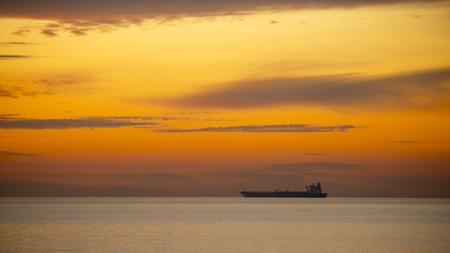 tanker ship: Tanker ship in ocean at sunset.