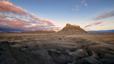 rock formation: Factory Butte, isolated, flat-topped sandstone peak near Caineville, Utah. Stock Photo