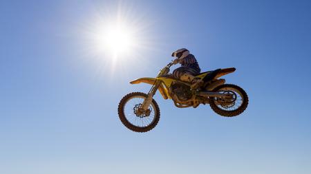Motocross racer jumping mid air Stock Photo