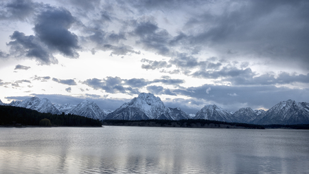 Teton mountain range at Jackson Lake at dusk, Stock Photo