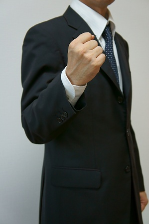 clench: Victory pose. businessman clench one
