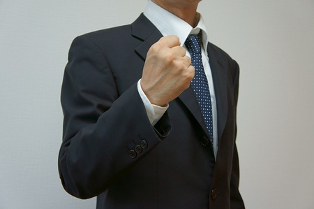 Victory pose. businessman clench one