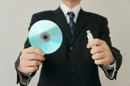 Information leakage attention. CD-ROM and USB memory am careful about information leakage. Stock Photo - 11692628
