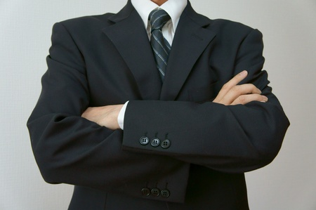 fold ones arms: fold ones arms. Businessman crossing arms.