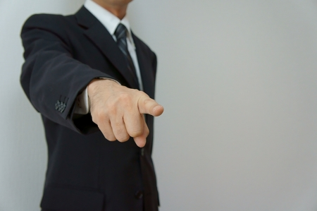 finger pointing: Pointed out. Businessman who points it out at conference etc. Stock Photo