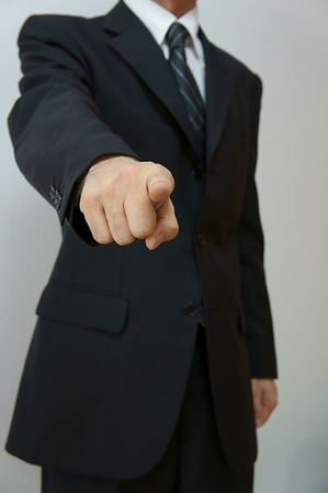 Pointed out. Businessman who points it out at conference etc. Stock Photo