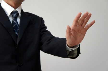 to restrain: Businessmen to restrain. Restrain an opinion of another person. Stock Photo