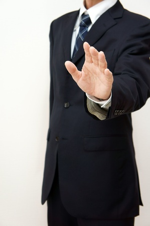 inhibition: Businessmen to restrain. Restrain an opinion of another person. Stock Photo