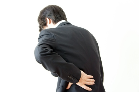 strained: Back pain businessman. Its waist is hurt and it slouches.