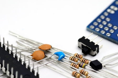 components: Electronic components. Capacitors and Resistors and Switches and Substrate and IC and Transistors.