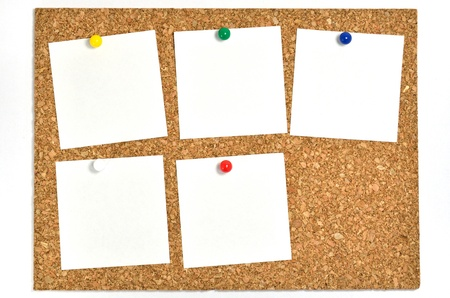 Cork board and blank notes. The blank notes of Five sheets stuck on the corkboard. photo