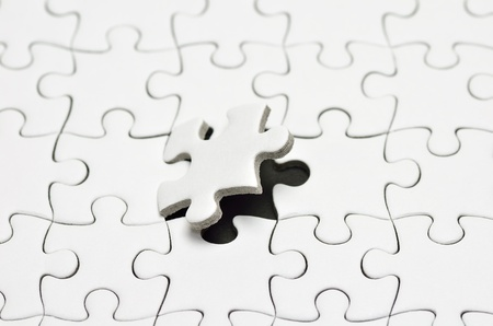 Plain white jigsaw puzzle, on Black background. Stock Photo - 13761817