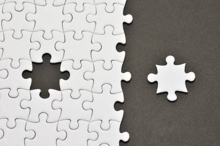 complete: Plain white jigsaw puzzle, on Black background.