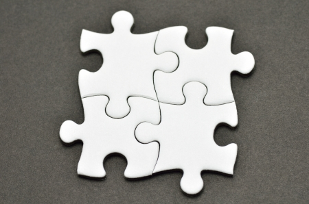 Plain white jigsaw puzzle, on Black background. photo