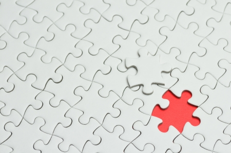 Plain white jigsaw puzzle, on Red background.