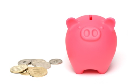 Pink piggy bank, isolated on white background. photo