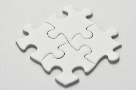 Plain white jigsaw puzzle, on White background. photo