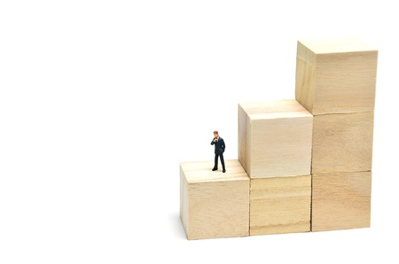 Stairs of square blocks and Businessman. (on white background) photo