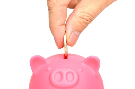 Pink piggy bank, isolated on white background. Stock Photo