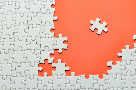 jigsaws: Plain white jigsaw puzzle, on orange background.