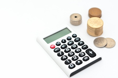 Calculator and japanese coin isolated on white background. Stock Photo