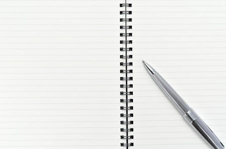 Notebook with Ballpoint pen (on white background) photo