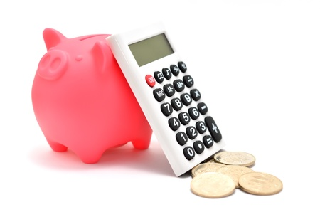 Piggy bank and Calculator and japanese coin. (on white background) photo