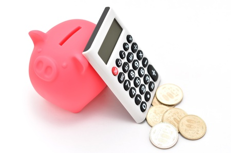 Piggy bank and Calculator and japanese coin. (on white background)