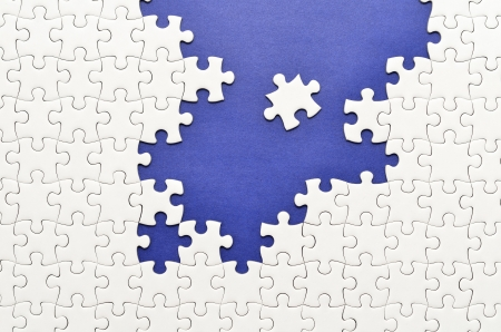 Plain white jigsaw puzzle. (Mount in dark blue) photo