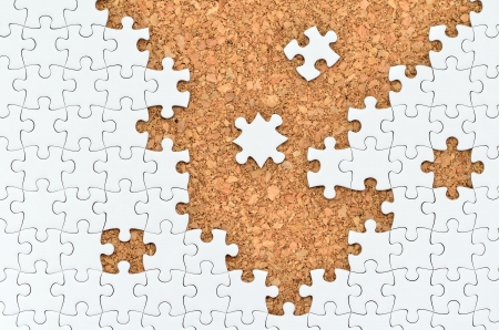 White jigsaw puzzle. (Mount in cork board) Stock Photo - 15814874