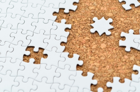 White jigsaw puzzle. (Mount in cork board) Stock Photo - 15814871