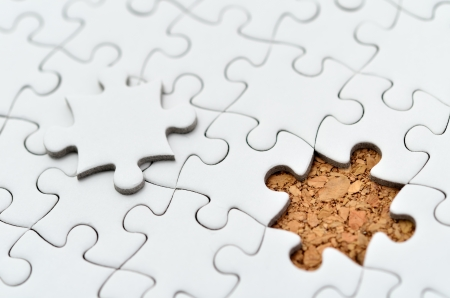 White jigsaw puzzle. (Mount in cork board) Stock Photo - 15814872