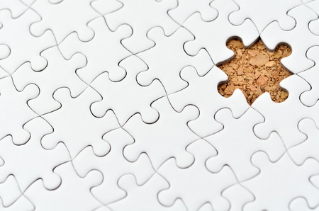 White jigsaw puzzle. (Mount in cork board) Stock Photo - 15814868