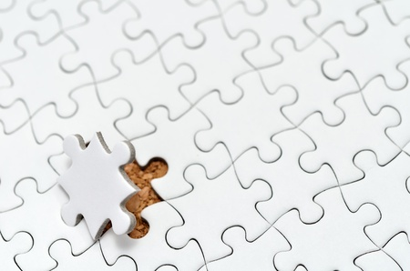 White jigsaw puzzle. (Mount in cork board) Stock Photo - 15814869