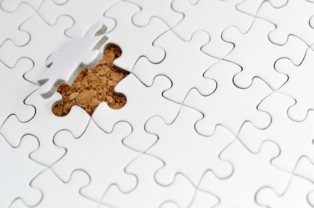 White jigsaw puzzle. (Mount in cork board) Stock Photo - 15814867