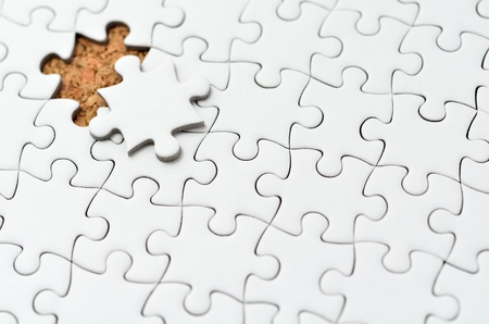 White jigsaw puzzle. (Mount in cork board) Stock Photo - 15814870