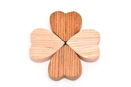 Four-leaf clover made of wood on white Background. photo