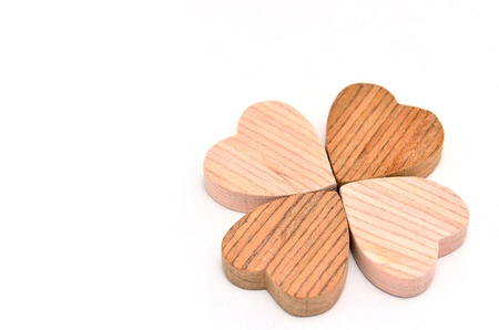 Four-leaf clover made of wood on white Background. Stock Photo - 16688970