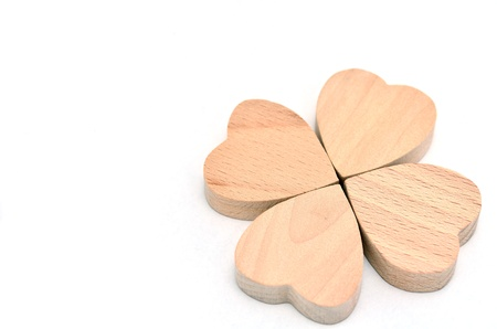 Four-leaf clover made of wood on white Background. Stock Photo - 16688983