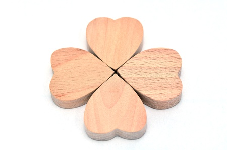 Four-leaf clover made of wood on white Background. Stock Photo - 16688974
