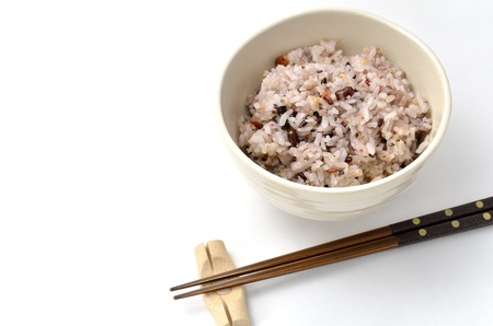 Mixed rice in japanese rice bowl (with Chopsticks and chopstick rest). Stock Photo