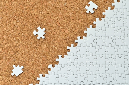White jigsaw puzzle. (Mount in cork board) Stock Photo - 16894821
