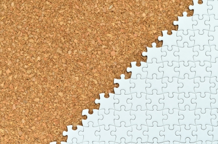 White jigsaw puzzle. (Mount in cork board) Stock Photo - 16894822