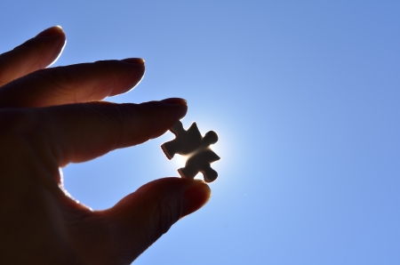 Plain white jigsaw puzzle on Background of blue sky and sun. photo