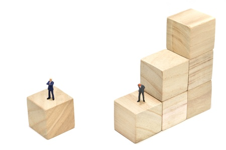 Businessman and Stairs of square blocks. (on white background) photo