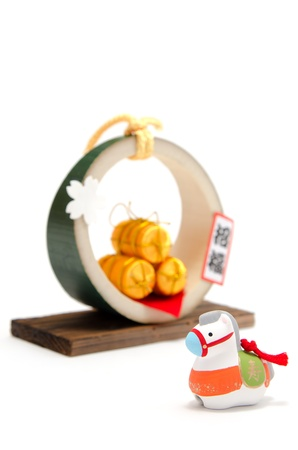 The Horse figurine and Three golden straw rice bags. (Japanese customs)