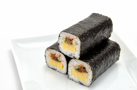 doufu: Rolled sushi isolated on a white . Stock Photo