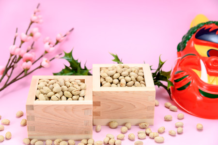 exorcism: Roasted soybeans and holly and plum blossoms. Japan of events called Setsubun. Stock Photo