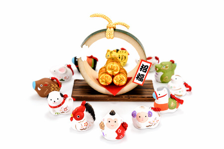 accessories horse: Figurines of 12 including the year of the Monkey. Figurines of the zodiac and Three golden straw rice bags. Stock Photo