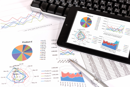 data management: Business performance analysis. Business Graphs with tablet, pen. Stock Photo